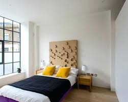 industrial bedroom ideas design ideas for an urban bedroom in with white walls and light hardwood flooring