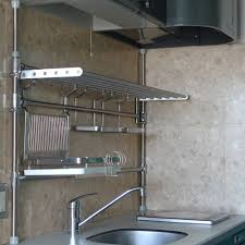 Kitchen:Minimalist Kitchen Design With Floating Stainless Steel Kitchen  Shelves And Green Standing Plant Idea