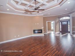 another option could be identifying the main source of light in your space and run the flooring perpendicular to the light