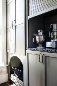 small garage doorKitchen Appliances Cabinet with Gray Garage Door  Transitional
