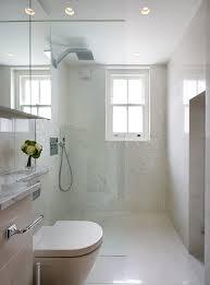 white small bathroom with white ceiling flooring walls white toilet white cabinet