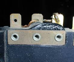 aftermarket fusebox for ferrari 308 and 512 series this is an example of a melted oem 308 fusebox from the back you can see the bus bar that connects the three terminals to distribute power