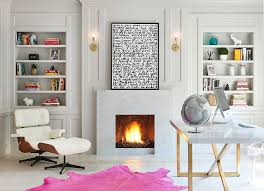 view in gallery relaxing contemporary home office in white with a fireplace eames lounger and colorful rug