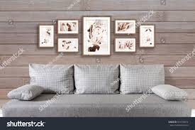 modern picture frames collage. Frames Collage With Floral Posters On Wooden Panels Wall Over Modern Couch, Interior Decor Mockup Picture E