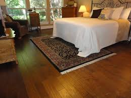 Classic style bedroom with hand scraped laminate flooring