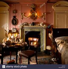 ornate bedroom furniture. Antique Furniture In A Pink Georgian Bedroom With An Ornate Gilt Mirror Above The Fireplace