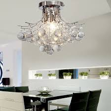 dining room interior design with black dining chair and glass dining table with modern light fixtures