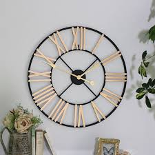 black and gold skeletal wall clock