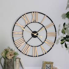 black gold skeleton wall clock roman