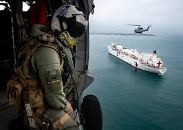 Naval Aircrewman Flies In An Mh 60s Sea Hawk Over The