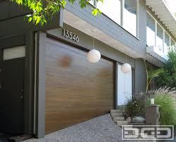 uneven threshold garage floor with a custom made garage door by dynamic doors modern