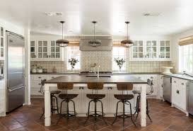 transitional kitchen white cabinets concrete countertop metal and
