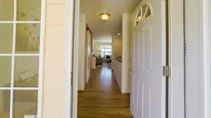 Walking through a modern American suburban home entering through the front door moving through the living room and into the kitchen Stock Video