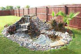 diy backyard pond backyard garden house design with small stone ponds with waterfall surrounded with green diy backyard