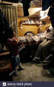 Inmate Evita Gomez, 38, and her daughter, 5, are seen in her room ...