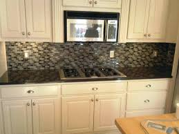 kitchens with glass tile backsplash amazing kitchen glass tile brown