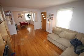 Open Floor Plan Living Room Furniture Arrangement Living Room White Sofa Cushions Wool Rugs Chandelier Ceiling