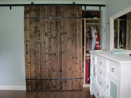 large reclaimed wood bypass sliding barn door with metal hardware for reach in bedroom closet