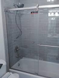 bathtub sliding frameless shower door