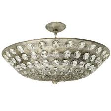 large silver leaf light fixture with crystals for