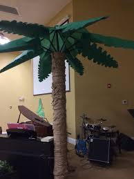 our biggest palm tree made of an outdoor umbrella thank