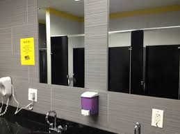 public bathroom mirror. Bathroom Public Mirror With Grey Wall Decoration Ideas Along Stainless Steel Faucets Also Black Countertop Idea