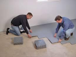 contractors installing basement suloor tileatting on a concrete basement floor in waterville maine
