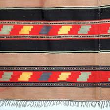 vintage handmade black brown wool rug with geometric designs 2