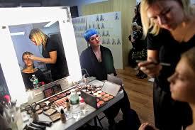 the mac senior makeup artist nicole thompson watching carole colombani work before the suno show credit yana paskova for the new york times