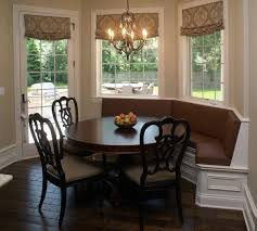 corner dining space in open kitchen using banquette seating