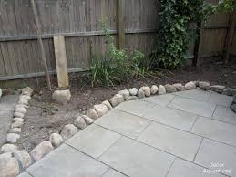 after the rock edging came the polysand this is the type that hardens into the crevices between the flagstone and bricks sort of like grout for tile