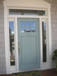 exterior soft blue wooden door with aluminum handle connected by double glass windows with white
