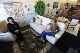 Becky Salgado, right, owner of a new quality consignment furniture store  named The Perfect