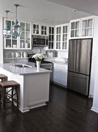 kitchen design white cabinets stainless appliances. Exellent Appliances Classic Small Kitchen With White Cabinetry Dark Wood Floors Stainless  Appliances A Doable Rehabilitationrenovation In Homes Limited Budget And Design White Cabinets Stainless Appliances I
