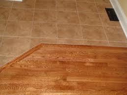 kitchen with tile and hardwood floors install hardwood laying floating floor over tiles