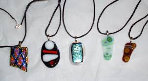 in 2016 i took a glass on making fused glass the final projects was pendants the far left and the center are dichroic glass which changes color when