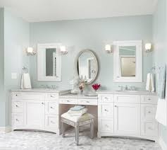 bathroom vanity uk company countertop combination: astounding white bathroom vanity design ideas showing storage flangked some drawer combined curving toekick and round round sink with update bathroom and