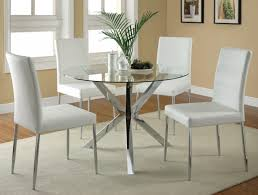 modern round glass dining table with chrome polished metal leg as well as elegant white leather dining chairs set