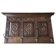 cast bronze wall coat rack with shelf