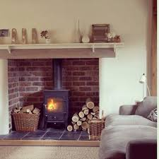 love this tweed cushions on the sofa and a basket of throws would complete this inglenook fireplacebrick