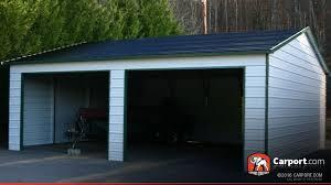 metal building with two garage doors 22 x 26