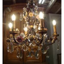 chandelier wrought iron cage with porcelain flowers