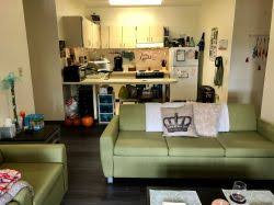 The living room and kitchen in a Single Apartment in the Village Apartments.