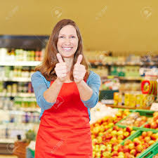 Smiling Female Store Manager Holding Both Thumbs Up In A Supermarket