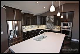 Dark Stained Maple Cabinets White Quartz Counters Cw Glass Mosaic