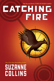 book review catching fire by suzanne collins the book publisher scholastic press