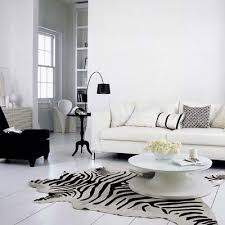 home and furniture eye catching zebra cowhide rug on white plank floor contemporary living room