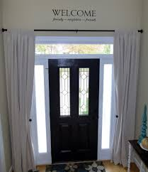 curtain for front doorCurtains over windows by front door Or to mimic sidelights if you