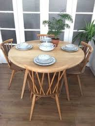 ercol vine table and chairs free delivery london candlestick ercol dining