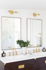 Bathroom Light Fixtures Above Mirror Gold Light Fixtures Above The Double Mirrors Bathroom